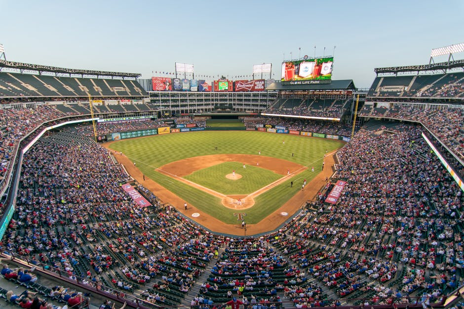 A large stadium with Globe Life Park in Arlington in the background