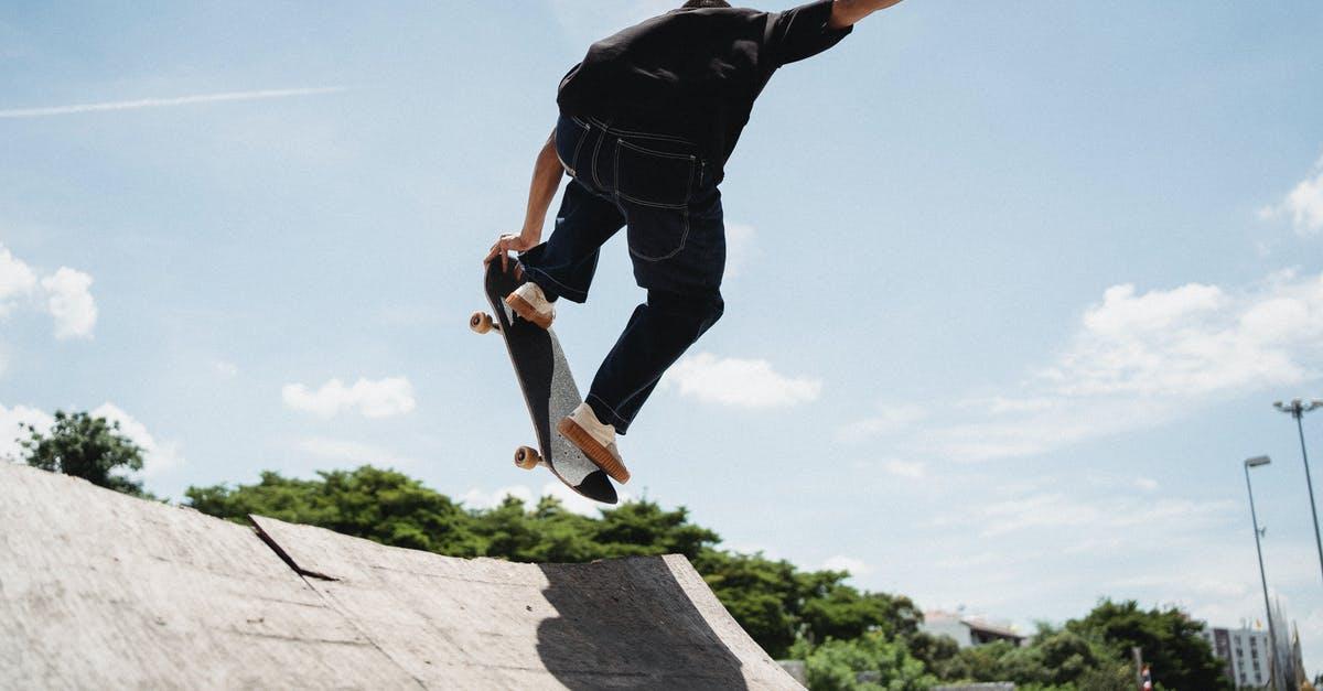 A man flying through the air while riding a skateboard
