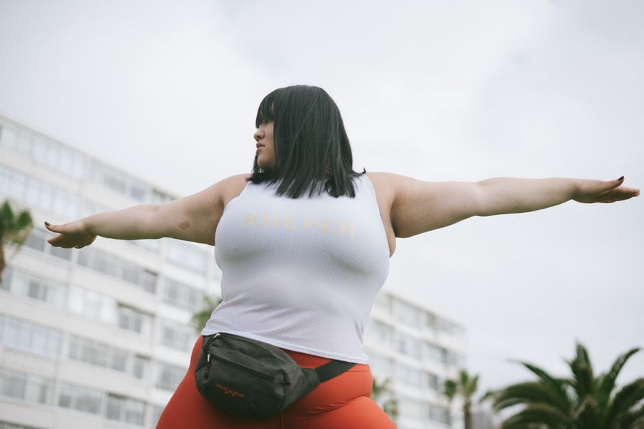 A woman jumping up in the air